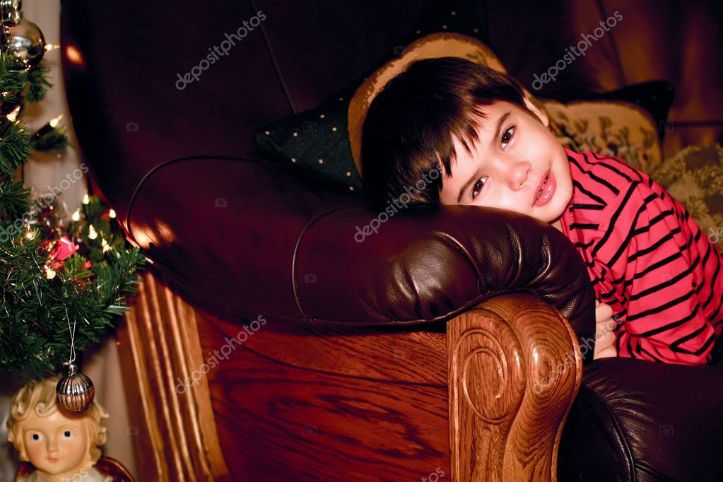 Boy looks out for christmas tree, indoor — Photo #8389902