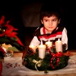 Foto Stock: Boy waiting for Santa Claus. The night. Spark. Christmas Ornaments