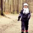 Cute kid taking a walk outdoor in the forest.  Autumn — Stok fotoğraf