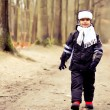 Cute kid taking a walk outdoor in the forest. Autumn — Stockfoto