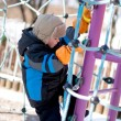 Little boy climbing on playground — Stock Photo #8979607