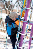 Little boy climbing on playground — Stock Photo
