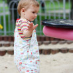 Beautiful boy playing on the playground - summer — Stock Photo