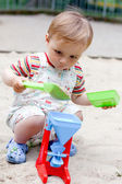 A little boy in the sandbox — Stock Photo