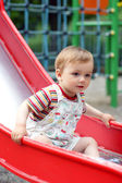Cute little boy come down from the children`s slide — Stock Photo