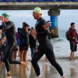 Triathlete running out of water — Stock Photo