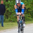 Ironman 2012 triathlete cycling — Stock Photo