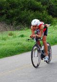 Triathlete Andi Boecherer cycling — Stock Photo