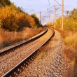 The railway with a bend on a sunset - Stock Photo