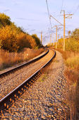The railway with a bend on a sunset — Stockfoto