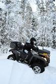 All-terrain vehicle got stuck in snow — Stock Photo