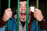 Man in a cell — Stock Photo