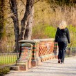 Attractive woman nordic walks in spring time - Stockfoto