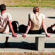 Young soaking up the sun on the bench — Stockfoto