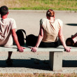 Young soaking up the sun on the bench — Stock Photo