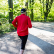 Stock Photo: Jogger in park