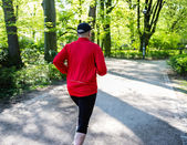 Jogger in park — Stock Photo