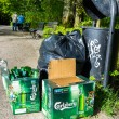 Carlsberg bottle beers near litter bin in Polish park - Stock Photo