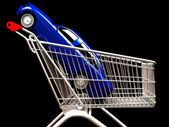 Shopping cart with car inside — Stock Photo