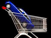 Nákupní vozík s autem dovnitř — Stock fotografie