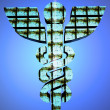 Stock Photo: Caduceus over a black background