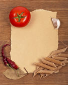 Products on a wooden, paper surface — Stock Photo