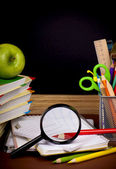 Stack of books, apple, globe and pencils — Stock Photo
