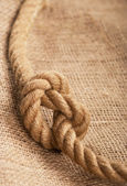 Frame make from rope laying on jute — Stock fotografie