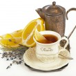 Tea in cup  and lemon — Stock Photo