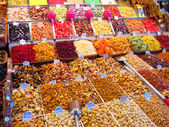 Sweets and dried fruits in the market — Stock Photo
