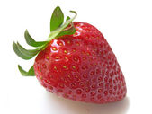 A single red strawberry isolated in white — Zdjęcie stockowe