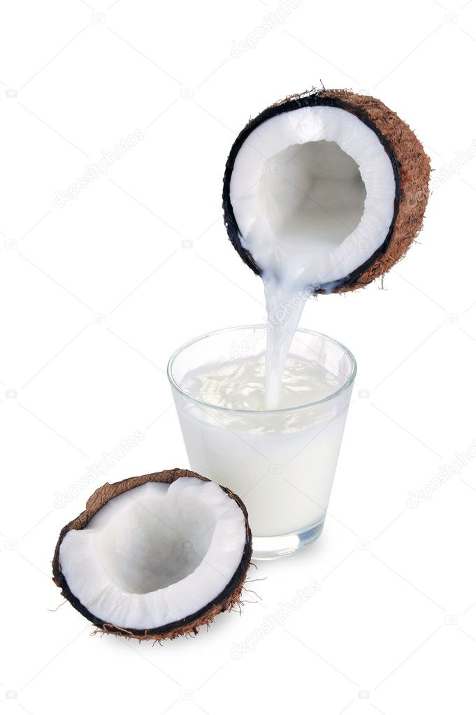 Coconut milk is poured from the nut — Stock Photo #8255592