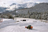 Clearing snow from the parking lot for cars — Stock Photo