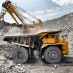 Loading of iron ore on truck — Stock Photo #9534552