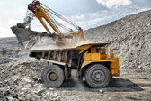 Loading of iron ore on truck — Stock Photo