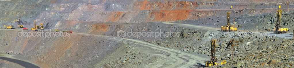 Panorama of an open-cast mine extracting iron ore  Stock Photo #9534745