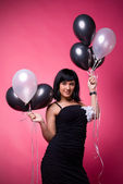 Attractive young girl with birthday balloons — Stock Photo
