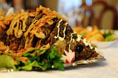 Baked carp on a table at restaurant — Stock Photo