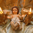 Christmas card, baby Jesus and two lighted candles — Stock Photo #8028917