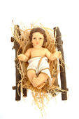 Nativity, baby jesus in his crib — Stock Photo