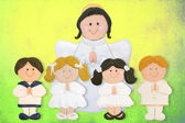 Cheerful first communion card, funny children with angel — Stock Photo
