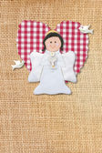 Cheerful first communion card, angel in rustic background — Stock Photo