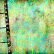 Transparent negative film by old grunge wall — Stock Photo
