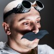 Man wearing false moustache and goggles — Stock Photo