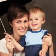 Stock Photo: Mother with baby in studio
