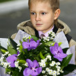 Boy with a bouquet - Stock Photo