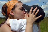 Kiss of mother — Stock Photo