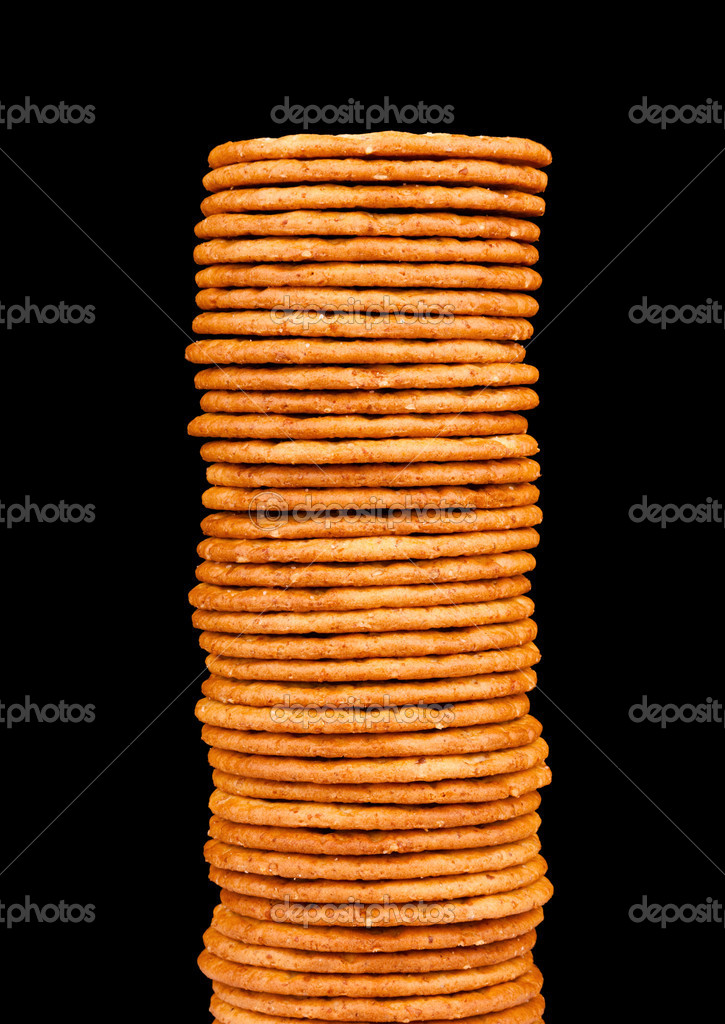 The high pile of delicious salty crackers isolated on a black background — Stock Photo #10230779