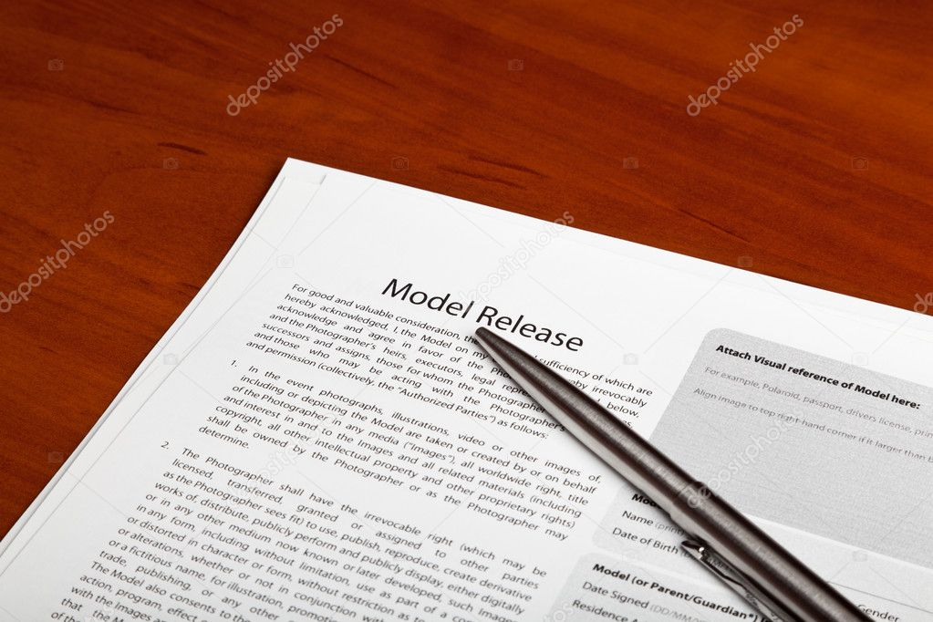 Several model release forms are on the table — Stock Photo #9901574