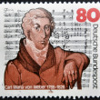 GERMANY - CIRCA 1986: A stamp printed in the Germany, shows Carl Maria von Weber on the background Mass in E-flat Major, circa 1986 — Stockfoto